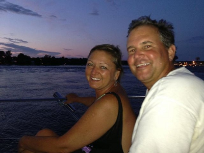 Kay Dolliver Harrison and Phil Decker on the water at dusk.